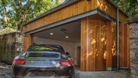 What is a Round-the-Corner Garage Door?